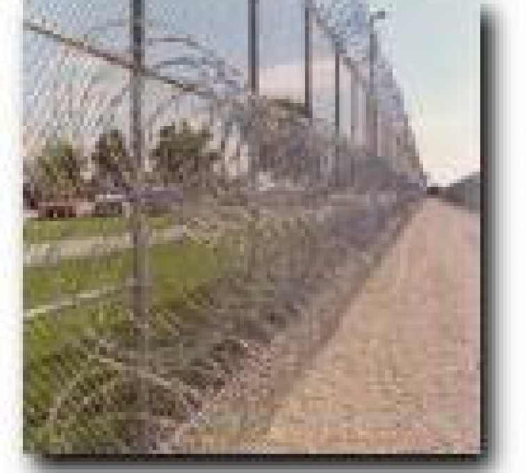 Kansas City Fence Company - High Security Fencing, 2105 concertina wire 3 coils