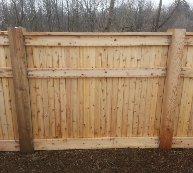AmeriFence Corporation Kansas City - Wood Fencing, 6' Custom Wood With Stone Columns - AFC- IA