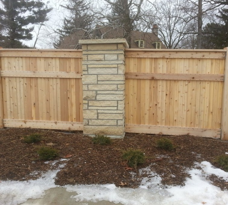 AmeriFence Corporation Kansas City - Wood Fencing, 6' Custom Wood with Stone Columns - AFC - IA