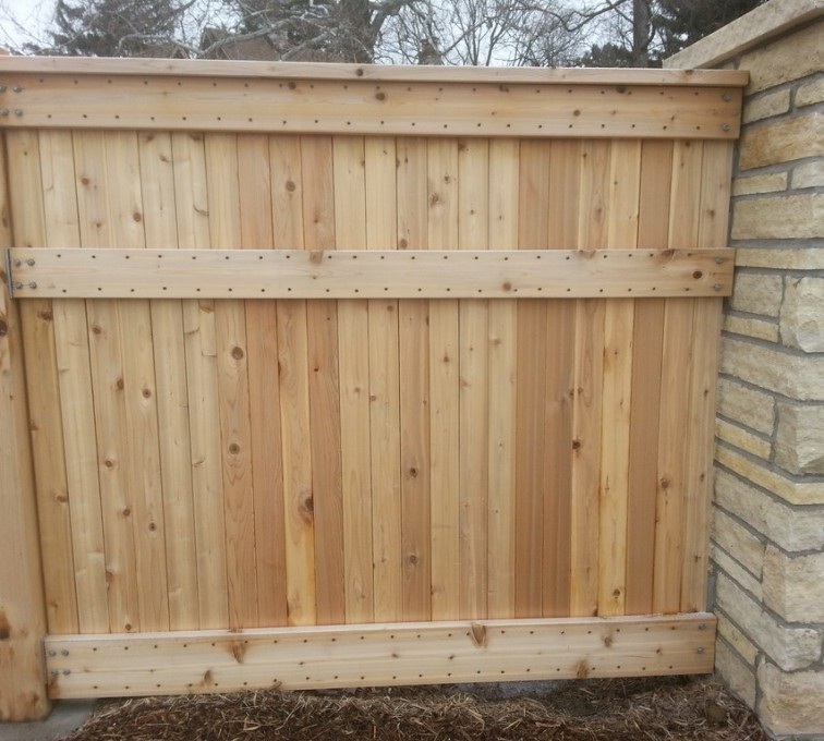 AmeriFence Corporation Kansas City - Wood Fencing, 6' Custom Wood with Stone Columns - AFC - IA