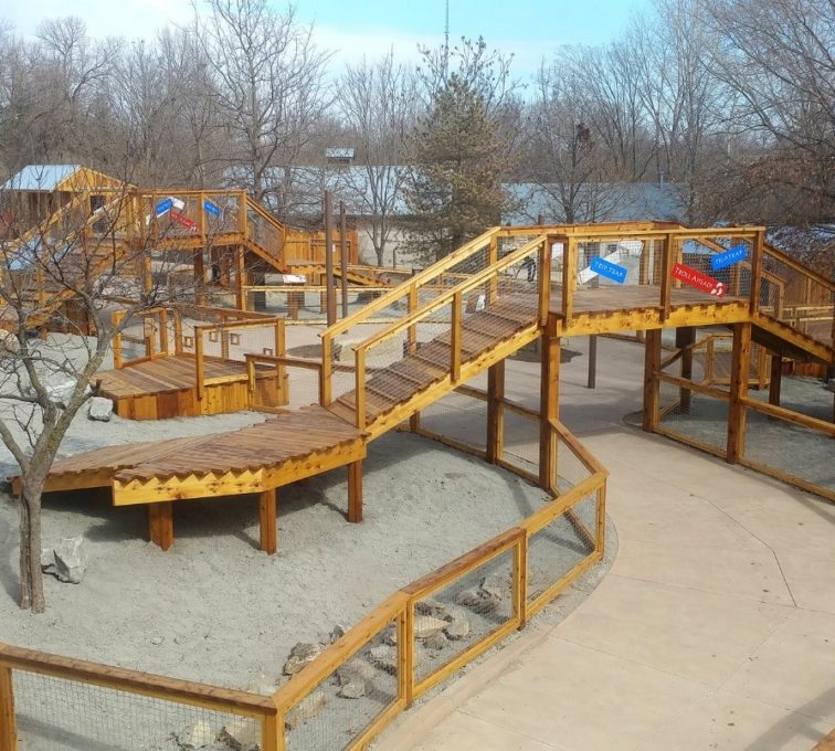 Custom wood fence and fenced off ramps and playground for goats and donkeys to play in separate from visitors. The fencing also includes wire mesh for optimal visibility and security